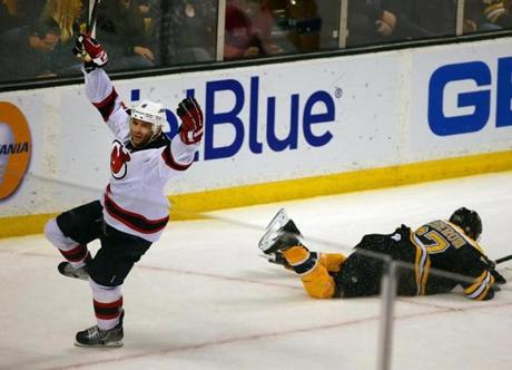 With Patrice Bergeron down, Andy Greene celebrated his winning goal.
